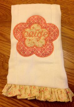 Personalized flower burp cloth. Every little girl needs one of these!! Check us out on Facebook. Sewcutechics #flowers #burpcloth#socute #baby ideas