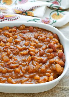 Slow-Cooker Mexican Baked Beans Recipe, filled with three different kinds of beans and plenty of spices. Get the recipe at barefeetinthekitchen.com