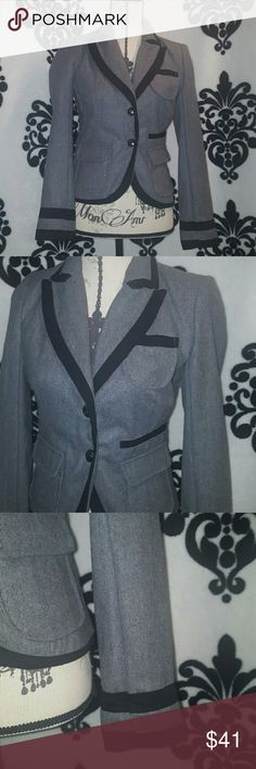 NEW LISTING MILITARY CUT JACKET NO SIGN OF WEAR. This is a military style dress jacket grey wool trimmed in black ribbon. Two buttons down the front, two pockets along the front 1 pocket just for looks. 50% wool, 50% polyester,  with polyester lining, dry clean only Jackets & Coats Blazers