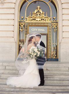 Romantic City Hall kiss: http://www.stylemepretty.com/2016/09/15/elegant-san-francisco-city-hall-wedding/ Photography: Caroline Tran - http://carolinetran.net/
