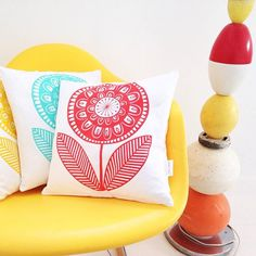 Screen printed Scandi flower cushions - the lamp base was made by a friend using her collection of beach buoys - goes well with the yellow chair! #janefosterhome #scandihome #retrohome #scandicushions #janefosterdesigna