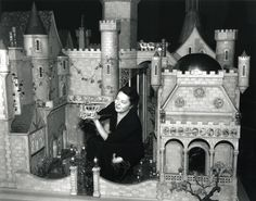 1950 - Colleen Moore American actress Colleen Moore  holds a miniature silver carriage as she sits in the garden of the Fairy Castle exhibit at the Museum of Science and Industry, Chicago, Illinois, late 1940s or early 1950s. A long-time doll house enthusiast, Moore had commissioned the castle which she toured around the country to raise money for children's charity organizations before donating it permentantly to the Museum. (Photo by Museum of Science and Industry, Chicago/Getty Images)