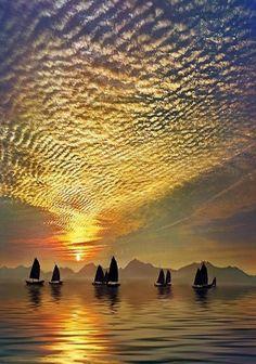 Fishing at sunrise,  by Ho Yau Ming Charles, Hong Kong.