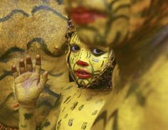 Little boy painted as a tiger celebrates harvest festival of Onam (© Sivaram V - Reuters)