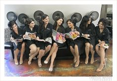 Super cute Salon photo! wearing aprons/smocks only!