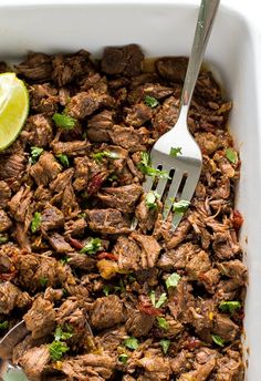 Melt in your mouth Slow Cooker Barbacoa Beef. Cooked low and slow for 8 hours!Perfect for tacos, burritos and quesadillas!