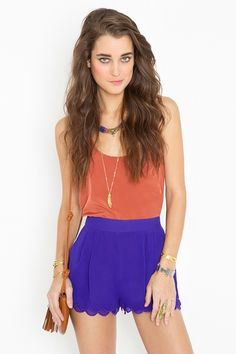 purple scalloped shorts that could be paired with a light peach lacy tank and brown ankle booties