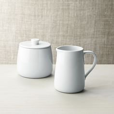 Classic simplicity in pristine white porcelain. This versatile, durable sugar bowl with a friendly tapered shape, knob lid and glazed finish makes a perfect serving pair with the coordinating creamer.