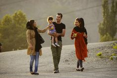 An Iranian family go for a stroll in Tehran. Image by Amos Chapple / Lonely Planet Images / Getty