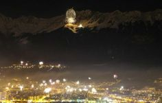 New Year's Eve ~ December 31, 2013: Midnight January 1, 2014 fireworks explode over the city of Innsbruck, Austria and the Nordkette mountains during New Year celebrations. [Part of Reuters photo gallery of New Year's Eve around the world. Click to see it.]