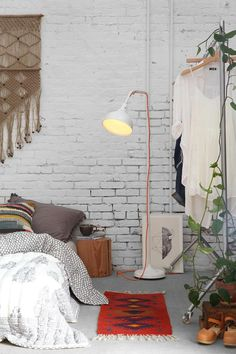 We can't forget the way white brick beautifully complements Boho modern style. And nobody has used white brick walls to the fullest quite like Urban Outfitters. In the image below, we see a white bric Decoration Inspiration, Interior Inspiration, Decor Ideas, Bedroom Inspiration, Decorating Ideas, Decorating Websites, Bedroom Inspo, Bedroom Ideas, Home Bedroom