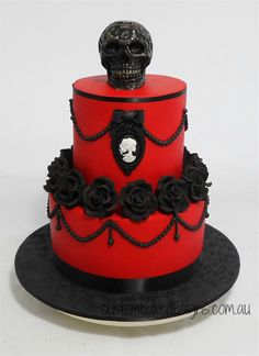 This cake was made for my clients best friend who wanted a tasteful Gothic themed cake that had red, black and skulls – so this is what I came up with :) The top skull is a white chocolate skull that has been airbrushed black and the skull cameo. Skull Wedding Cakes, Gothic Wedding Cake, Halloween Wedding Cakes, Theme Halloween, Skull Cakes, Red Wedding Cakes, Devil Halloween, Camo Wedding, Unique Cakes