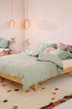 Pastel bedroom | shop the room: duvet cover - rug - round pillow - side table - floral pillowcase