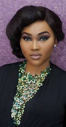 Nollywood actress Mercy Aigbe wore the classic smokey eye with a twist as she chose a blue, plum and navy blue mix for the eyes and perfectly drawn out cat eye with defined brows paired with nude lips. Check out the finished look...