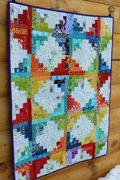 Sunshine and Showers Baby Quilt by CoraQuilts~Carla, via Flickr- two of my favourite things….log cabin and brights..