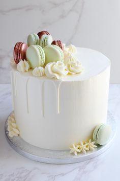 Lemon and Elderflower cake with a vanilla drip, mint green and rose gold macarons Lemon Birthday Cakes, White Birthday Cakes, 13 Birthday Cake, Macaron Cake, Macarons, Baby Shower Drip Cake, Beautiful Cakes, Amazing Cakes, Mint Green Cakes