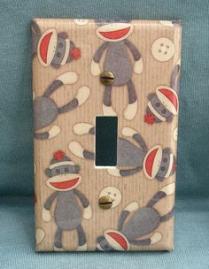 Light Switch - cover with wallpaper or scrapbook paper and then seal...