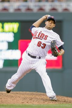 Jun 30, 2014; Minneapolis, MN, USA; Minnesota Twins starting pitcher Johan Pino (63) pitches in the fifth inning against the Kansas City Royals at Target Field. The Kansas City Royals win 6-1. Mandatory Credit: Brad Rempel-USA TODAY Sports