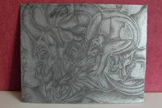 Acid etched printmaking metal panel. I covered this panel in a special layer of wax, then drew (etched) into the wax, then plunged the panel into an acid bath. The acid eats away at the exposed metal, leaving the reminder under the wax, untouched. When the wax is then removed, you have an acid etching ready to be printed from!