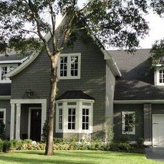 Medium Grey exterior, white trim, white gutters, grey roof.