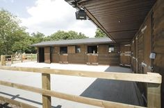 Timber stables with corner unit (Redmire stables, UK)