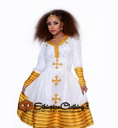 This Ethiopian traditional clothes new style is a true example of modern Ethiopian dresses. Exclusively from our beautiful Ethiopian clothing store, created keeping design elements of the Ethio Habesha dress, this brand new design is sure to steal your heart away.You could choose to buy this for yourself or even gift it to your loved one and watch them gasp with surprise and pleasure! What makes the dress brilliantly attractive is the golden embroidery around the neck and front accented…