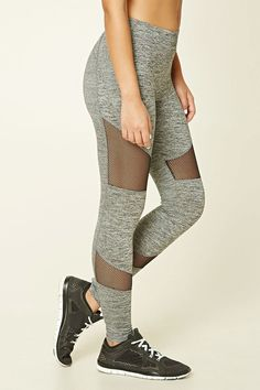 A pair of knit leggings featuring a marled pattern, mesh panels, a hidden key pocket, elasticized waist band, and moisture management.