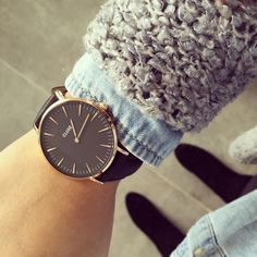 Diana wearing her black and gold CLUSE watch!