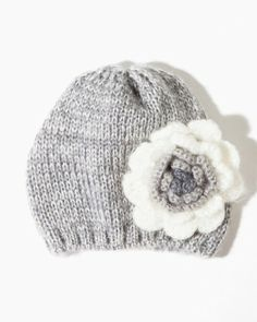 This cute beanie is a great gift idea! Rosette Knit Beanie | Cold Weather | charming charlie