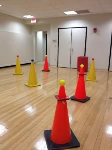 Could set these up around gym with one team defending them and the other outside the gym lines throwing at them. Trying to have most balls up to win
