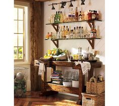 Saw this from the Spring Pottery Barn catalog and LOVE the bar on the wall (not the clutter look below). HMM!