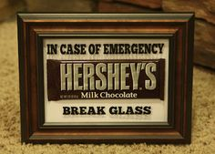 I thought this was funny. It would be super cheap to do as well: frames from the share shop, sharpie words on the inside of the glass, favorite candy inside :)