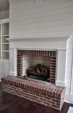 white shiplap walls with brick fireplace - Google Search