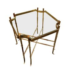 Sophisticated gilt wrought iron table with square top with edged corners. Double crosshatch design on lowers bars.