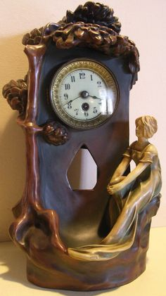 Gorgeous art nouveau ceramic clock by Schwarz, Austria, lady at well under tree,    ca. 1890