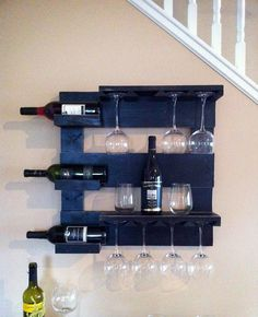 """This beautiful wine rack is made from reclaimed pine that I have painted black and distressed. It measures 24"""" x 24"""" with 3 shelves and wine glass holder. This rustic wine rack will look great in any room! Great gift idea!"""