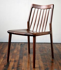 A modern solid wood dining chair, designed and hand made by Jason Lewis.