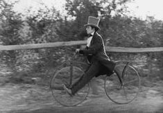 Comedian and Actor Buster Keaton. Wow! Look at those wheels he's riding - Vintage bicycle!