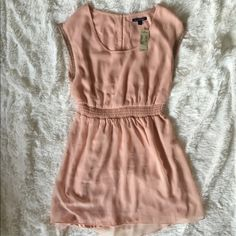 NWT AMERICAN EAGLE dress I bought this and it was way too big. It says it's an XS but I swear it could fit a small or even a medium. USE THE OFFER BUTTON!  American Eagle Outfitters Dresses