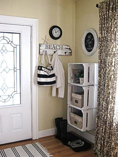 diy entryway - these look like really inexpensive (or free) frout crates painted white. Nice color combo