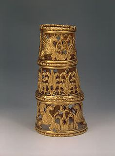 Sythian Cone with Griffins, Palmettes and Lotuses Gold, garnets and almandines; stamped, soldered, repousse, and decorated with inlay, 4th - 3rd century BCE