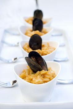 maybe this would be a good app for tomorrow night....Remy loves seafood! Lovely Presentation: Mussel risotto