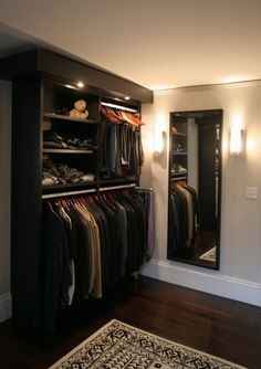 Venetian Wenge walk-in closet with short hanging and shelving.