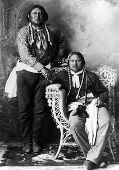 Studio portrait of Native American Comanche men, Too-ah-nipper standing, and Neh-nah-co-ey seated in a wicker chair, posed shaking hands - Native American Pictures, Native American Quotes, Native American Beauty, Native American Tribes, American Indian Art, Native American History, American Indians, American Symbols, Native Indian