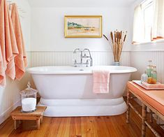 Would like it in blue..............Salmon-colored accents give this bath a subtle hint of color. See ways to add seating to any bathroom here: http://www.bhg.com/bathroom/remodeling/planning/bathroom-design-ideas--add-seating/?socsrc=bhgpin092712salmoncoloredbath#page=6