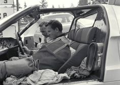 Phil Hill & Bruce McLaren. Hill , in the background, discusses the ...