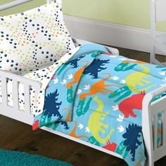 This dinosaur toddler bedding set creates a prehistoric feel for a child's bedroom that any toddler will love. The four piece set comes with a colorful comforter and sheet set to fit a toddler size be