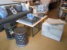 Grey with blue accents in pillows and coral is the epitome of style at East Hampton.