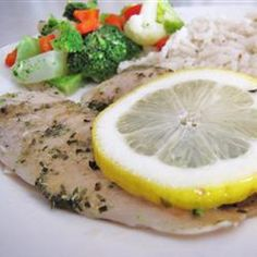 Easy Baked Tilapia Recipe - I added an extra 5 minutes or so to the baking time, since I was using frozen tilapia. I used frozen peas instead of the veggie mix, and I served it with a baked potato that I started in the oven earlier. Delicious! #ggfavorite