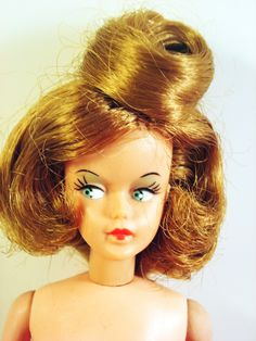 1960s Tressy Doll   Tressy has a long piece of hair that comes out of the top of her head